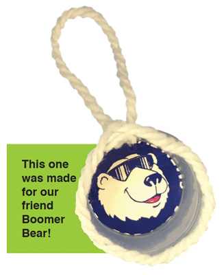 Yarn ornament. Boomer bear cutout of paper is glued on top.