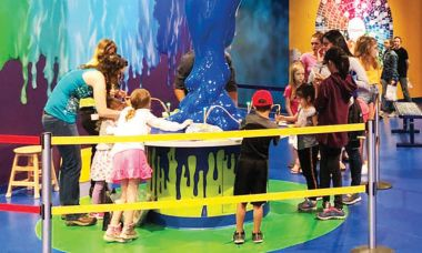 Kids try the Crayola Meltdown station