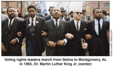 Voting rights leaders march from Selma to Montgomery, AL in 1965. Dr. Martin Luther King Jr. in center